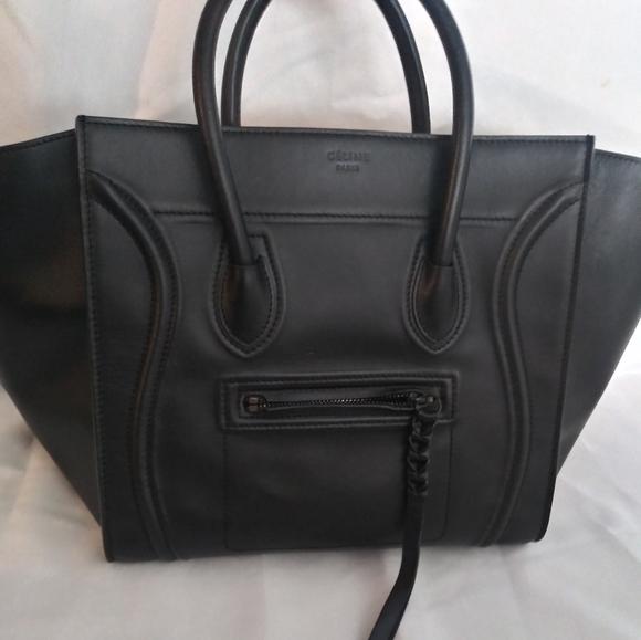 Celine Phantom luggage bag with tags